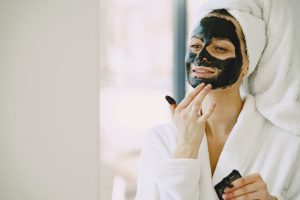 photo-of-woman-applying-clay-mask-on-her-face-4148921